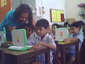 Teacher Poonam helps one of the children.